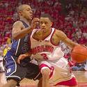 Maryland's Juan Dixon drives the baseline in front of Duke's Jason Williams during the second half.