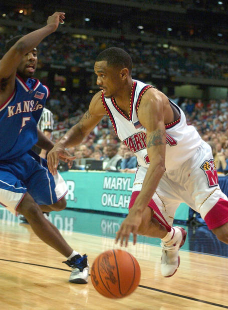 Maryland guard Juan Dixon drives past Kansas' Keith Langford in the second half of the Terps' 97-88 win.