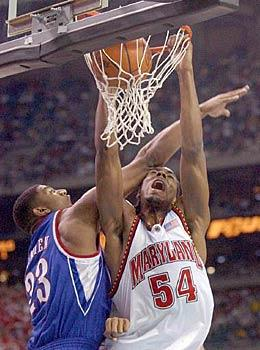 Maryland forward Chris Wilcox slams in two points as Kansas' Wayne Simien goes for the block in the first half Saturday.