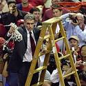 Maryland coach Gary Williams cuts down the net at Cole Field House after the Terps beat Virginia, 112-92.