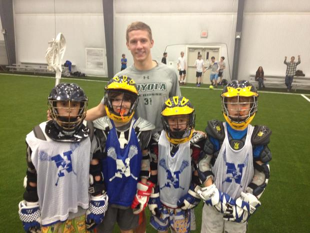 Trip organizer Jason Crane (Chesapeake-Anne Arundel) with players from Newtown.
