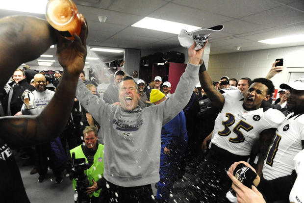 Coach John Harbaugh is sprayed with champagne after the Ravens won the AFC championship.