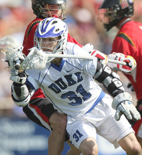 Duke's Jordan Wolf charges toward the Maryland goal. The Terps beat the Blue Devils, 11-9, in Durham, N.C. to claim the Atlantic Coast Conference tournament championship.