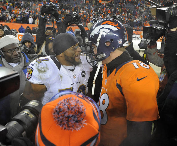 Ravens linebacker Ray Lewis, left, receives congratulations from Denver Broncos quarterback Peyton Manning after the game.