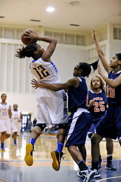 Aberdeen's Jimmia McCluskey, left, shoots over Poly's Jasmine Smith during the Basketball Academy at Morgan State.