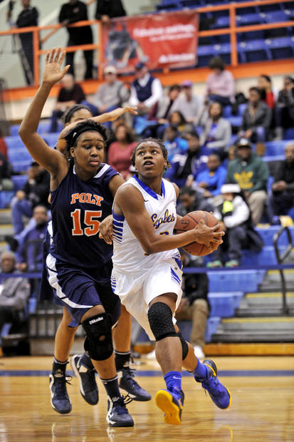 Aberdeen's Jimmia McCluskey, right, drives past Poly's Nkeiruka Okororie during the Basketball Academy at Morgan State.