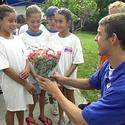 Young admirers present roses to Phelps