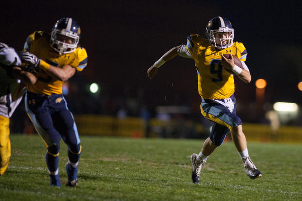River Hill quarterback Austin Altman, right, runs with the ball against Mount Hebron.