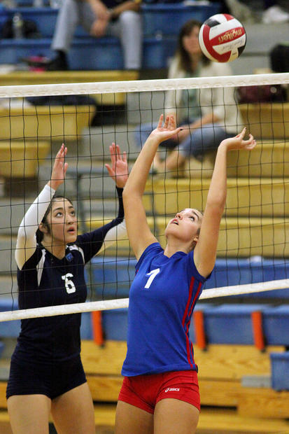 River Hill's Emily Luo, left, watches the ball as Centennial's Lexi-White-Torruellas hits the ball.