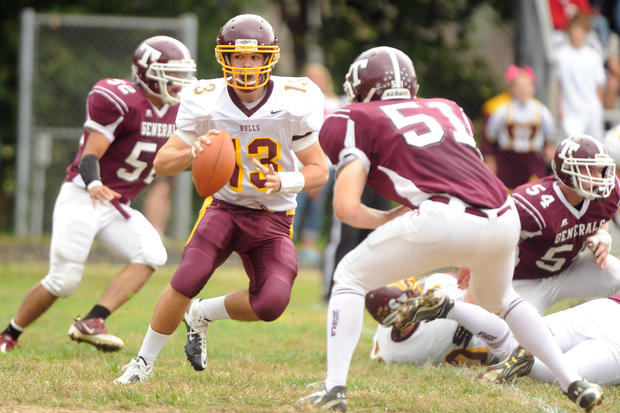 Hereford quarterback Ryan Jones, center, looks for running room against Towson.