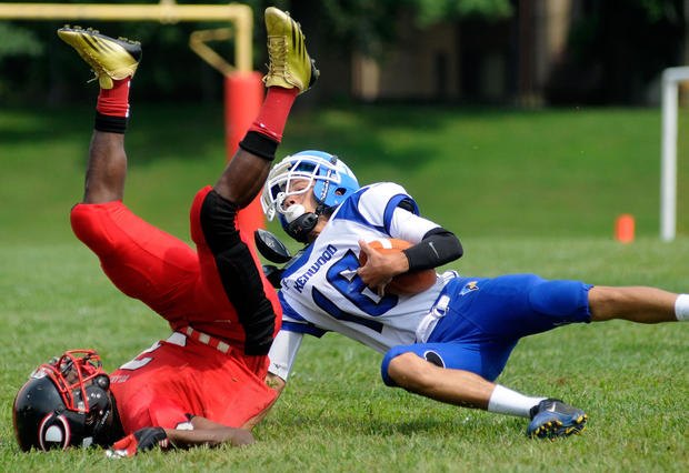Dulaney's Chris Davis tackles Kenwood's Willie Johnson after Johnson's interception in the first half.