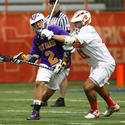 Syracuse defenseman Brian Megill (right), Albany midfielder Matthew Green