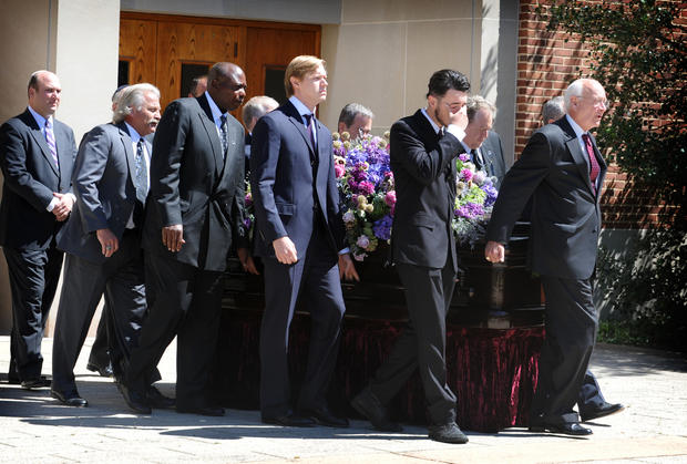 Pall bearers bring out the casket of former Ravens owner Art Modell at the Baltimore Hewbrew Congregation. Among the bearers was Ravens General Manager Ozzie Newsome, third from left.