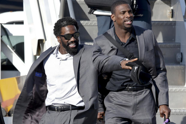 Ravens safeties Ed Reed, left, and Bernard Pollard arrive in New Orleans, La., to prepare for Super Bowl XLVII.