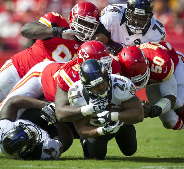 Ray Rice is tackled by several Chiefs.