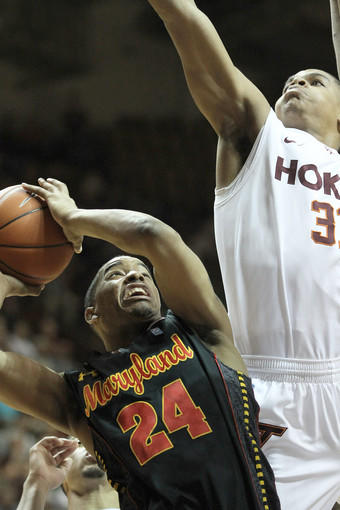 Maryland guard Cliff Tucker is blocked at the basket by Virginia Tech forward Jarell Eddie. Tucker finished with 10 points on 4-for-10 shooting from the field.