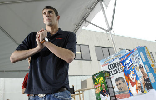 "Michael Phelps announced that he has signed a deal with Kellogg's to appear on boxes of Corn Flakes, Frosted Flakes, Rice Krispies Treats and Club Crackers, and the company also presented his foundation with a check for $250,000. ""My friends were joking with me, asking, 'So you're going to be [on cereal boxes] with Tony the Tiger?' "" Phelps said. ""I said, 'Yup.' Pretty cool."""