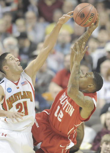 Greivis Vasquez blocks the shot by Houston's Aubrey Coleman in the first half.