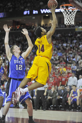 Maryland's Sean Mosley drives to the hoop past Duke's Kyle Singler during the first half.