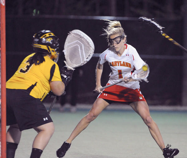 Maryland's Sarah Mollison, right, scores on Towson's Mary Teeters for the Terps' 10th goal.