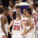 Gary Williams huddles with his team