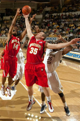 Maryland forward Dave Neal (35) grabs a rebound from Georgia Tech forward Zachery Peacock (35) while Sean Mosley (14) backs up Neal during the first half.