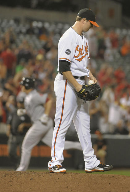 Orioles starter Zach Britton reacts after giving up the first home run of Ryan Lavarnway's major league career. The Red Sox catcher added another homer in the eighth inning, this one off reliever Zach Phillips.