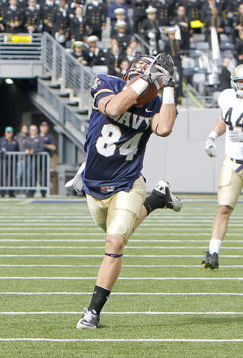 Navy Midshipmen wide receiver Greg Jones (84) catches a long pass over his shoulder during the second half against the Notre Dame Fighting Irish.
