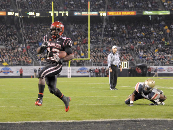 San Diego State's Ronnie Hillman scores on a 1-yard touchdown run in the fourth quarter of the Aztecs' 35-14 victory over Navy in the Poinsettia Bowl at Qualcomm Stadium in San Diego.
