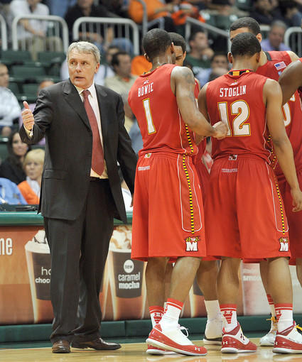 Maryland Terrapins head coach Gary Williams talks with his players during a timeout.