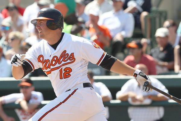 Orioles third baseman Mark Reynolds connects on a one-run single during a spring training exhibition game against the Pirates at Ed Smith Stadium.