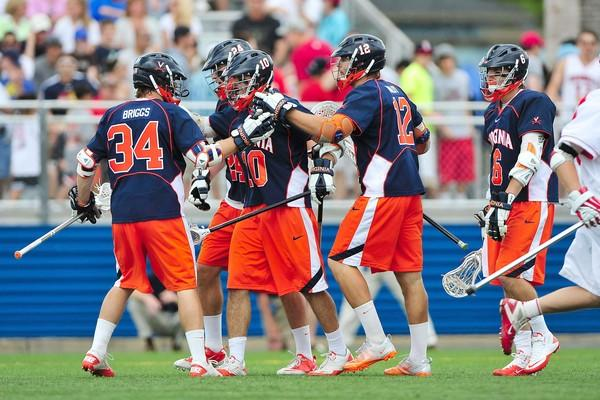 Virginia players, including Chris Bocklet (10), John Haldy (12) and Colin Briggs (34) celebrate a first-quarter goal.