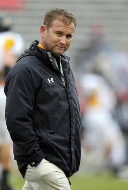 Towson coach Rob Ambrose is shown before his team's game against Maryland at Byrd Stadium.