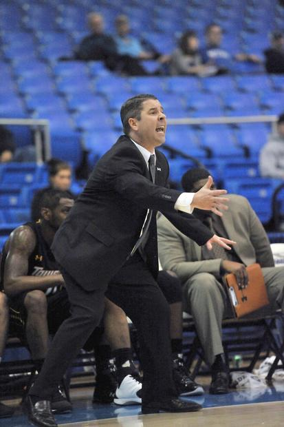 Towson coach Pat Skerry guides the Tigers against the Spartans.