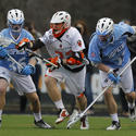 Princeton midfielder Tom Schreiber (center), John Hopkins defensemen Nikhon Schuler (36) and Tucker Durkin