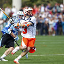 Virginia midfielder Ryan Tucker (3), John Hopkins midfielder Marshall Burkhart