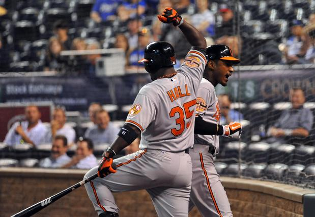 The Orioles' Bill Hall and Adam Jones celebrate Jones' game-winning solo homer against the Royals in the 15th inning.