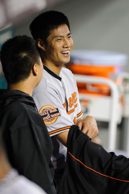 Orioles starting pitcher Wei-Yin Chen  smiles in the dugout after going six innings without giving up a hit or walk against the Mariners.