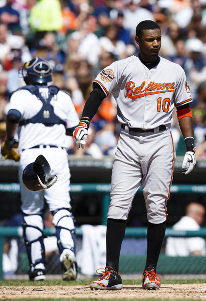 Adam Jones throws his helmet to the ground after striking out in the sixth inning against the Tigers.