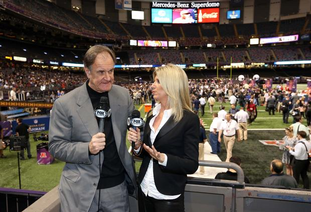 Former Ravens coach Brian Billick is interviewed by Fox reporter Laura Okmin during Super Bowl Media Day.