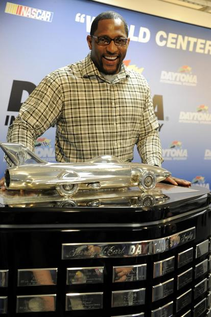 Ray Lewis poses with the Harley J. Earl Trophy at a news conference for the Daytona 500.