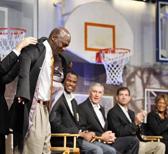 Michael Jordan is fitted with his Hall of Fame jacket during a press conference with fellow inductees David Robinson, Jerry Sloan, John Stockton and Vivian Stringer at the Naismith Memorial Basketball Hall of Fame.