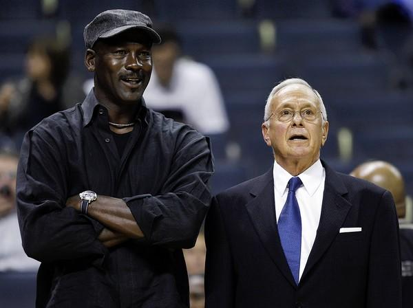 Bobcats coach Larry Brown talks with managing partner Michael Jordan before an game.