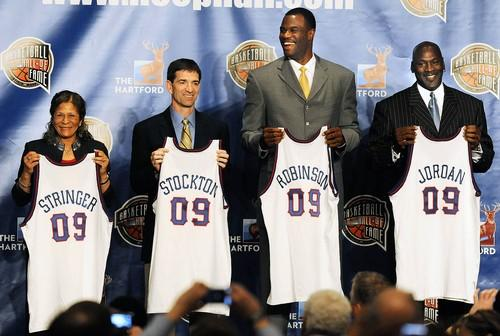 Rutgers women's coach C. Vivian Stringer, John Stockton, David Robinson and Michael Jordan hold jerseys at the announcement that they were elected to the Basketball Hall of Fame. Utah Jazz coach Jerry Sloan is also part of the 2009 class.