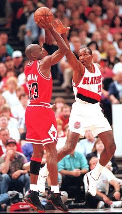 But 1991 was merely the beginning of Jordan's odyssey. Here he shoots over Clyde Drexler in the 1992 NBA Finals…