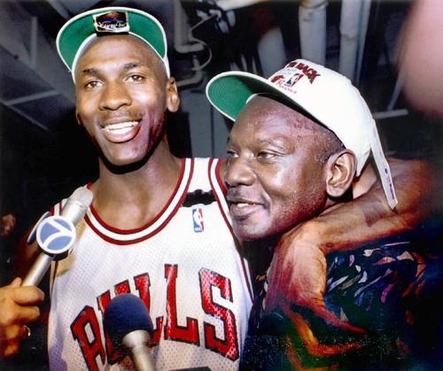 …and Jordan celebrates the Bulls repeat NBA championship with his father, James.