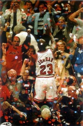 The Bulls followed that up with a scintillating Game 6 in the United Center, and Jordan indicates to the crowd how many titles the Bulls had amassed to that point.
