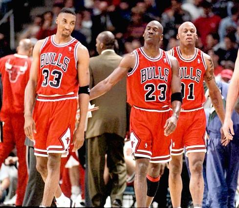 …but would return to dominance the following season, after adding Dennis Rodman (91). Here, Jordan, Scottie Pippen and Rodman celebrate the Bulls' NBA-record-setting 70th victory of the season, against the Bucks in Milwaukee.