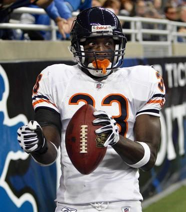 Charles Tillman dances in the end zone after making an interception and then scoring against the Lions.