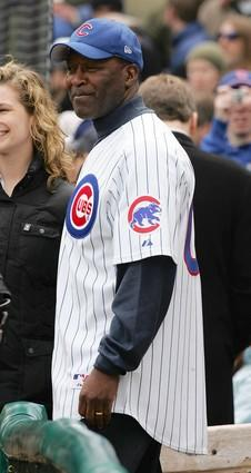 Lovie Smith watches Devin Hester throw out the first pitch before the Cubs' home opener with Houston.